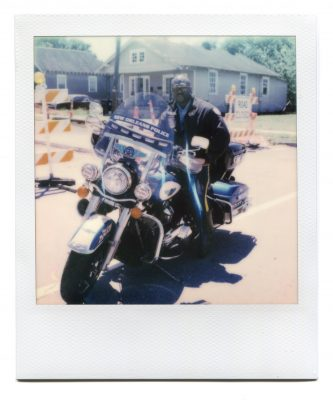 NOPD motorcycle cop. Polaroid by Florent Dudognon